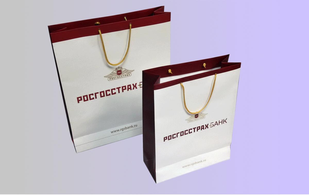 Бумажные пакеты банка формата А4+ и А3+, печать офсетная, красочность 5+0 (CMYK+Pt 873), матовая ламинация, люверсы, укрепленное дно, шнур белый.